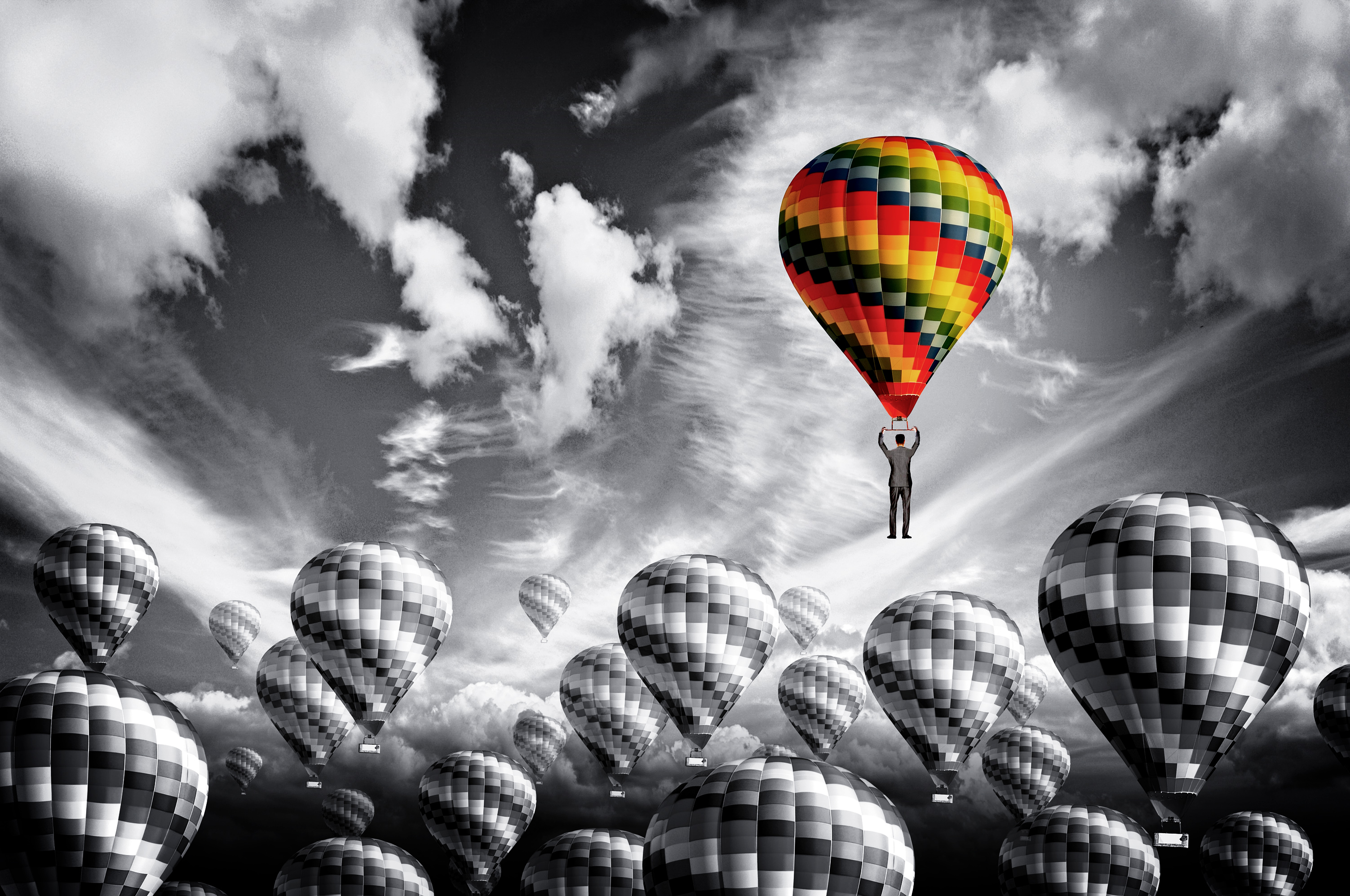stockvault-businessman-leader-rising-in-a-hot-air-balloon---leadership-concept179148jpg