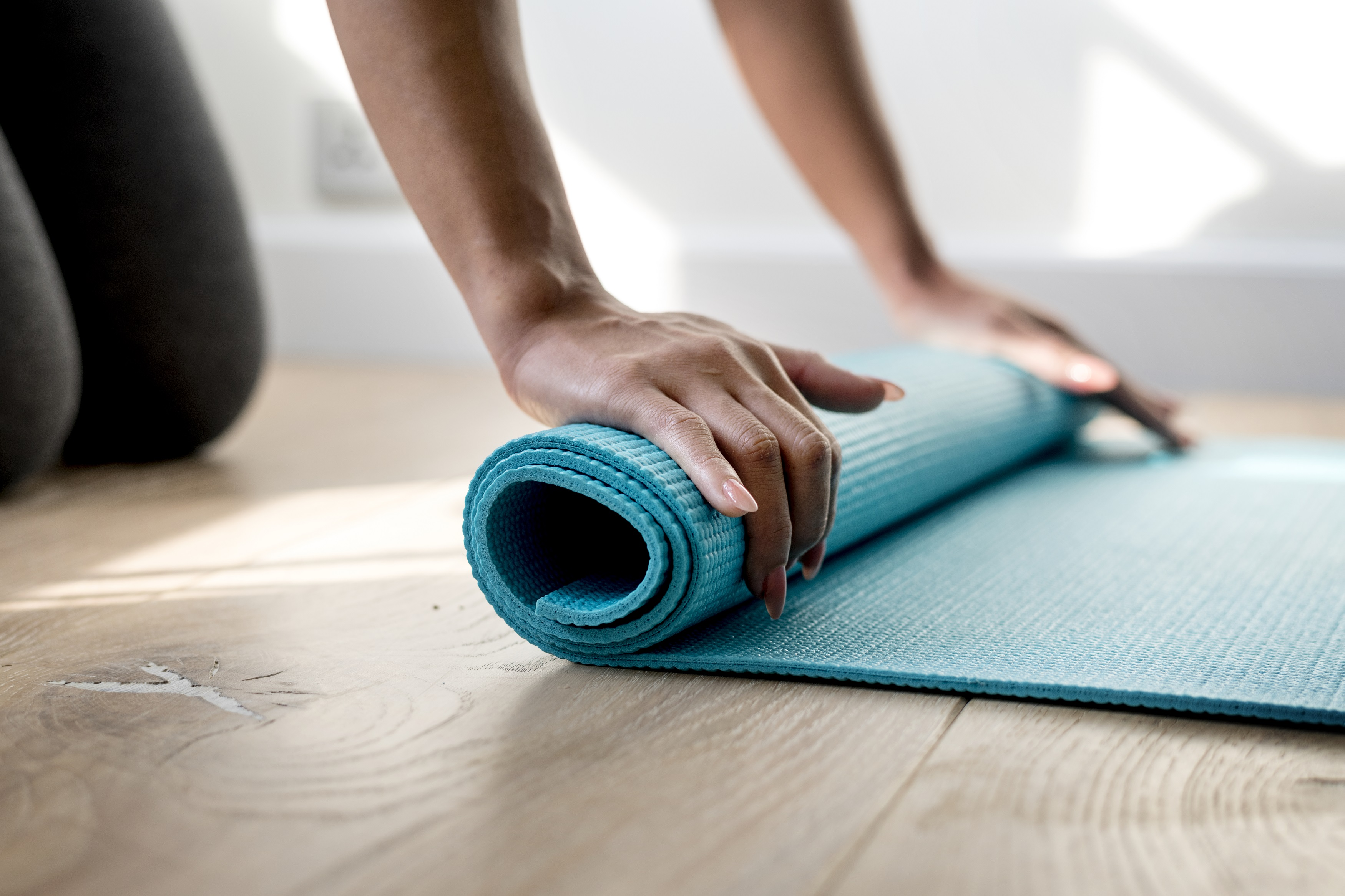 <a href='https://www.freepik.com/free-photo/woman-rolling-yoga-mat_2767710.htm'>Designed by Rawpixel.com</a>