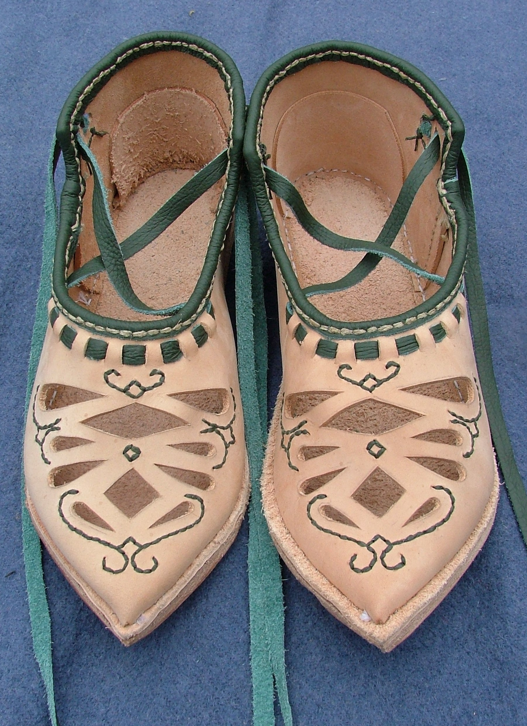 Open-work shoes embroidery.