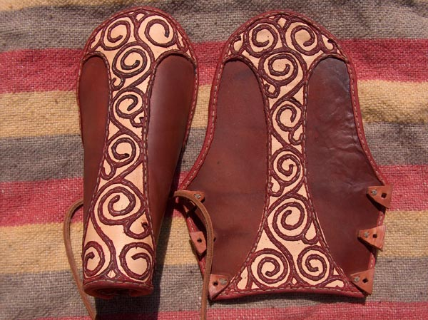 Leather vembraces with an ornament.