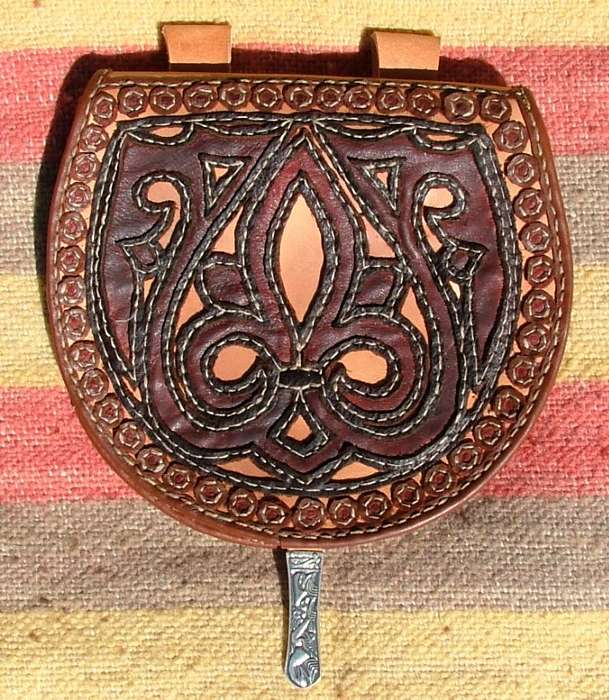 Pouch with a floral ornament.