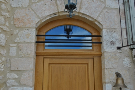 Arch wooden windows and doors