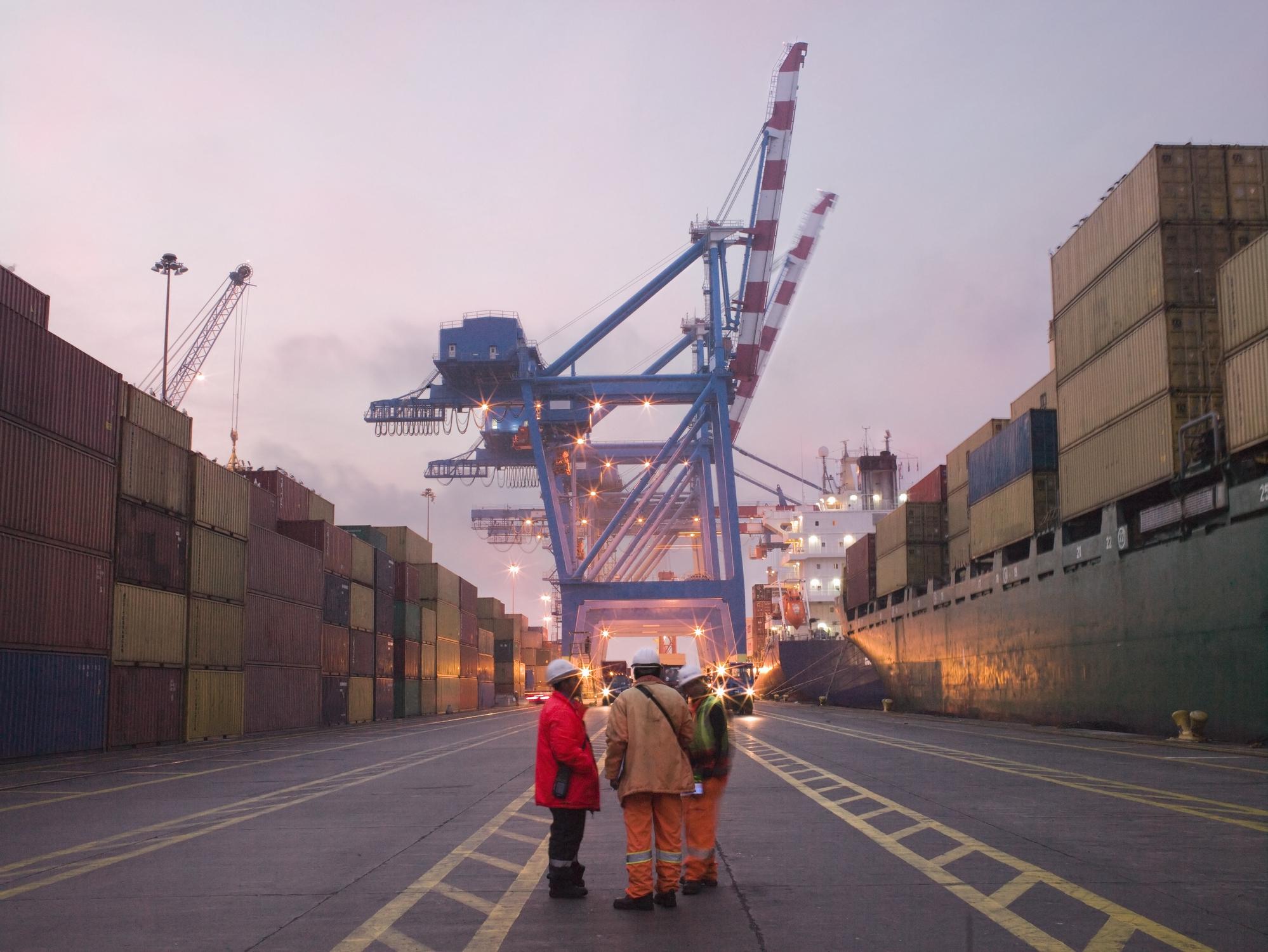 workers-talking-in-a-shipping-yardjpg